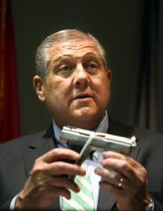 ATF Special Agent-in-Charge Jim Cavanaugh shows a gun that is similar to the gun in the Steve McNair shooting during a news conference at the US Attorney's office in Nashville, Tenn., Friday, July 17, 2009. Adrian Gilliam Jr. of La Vergne has been arrested in connection with the Steve McNair shooting, accused of supplying the gun. (JAE S. LEE / THE TENNESSEAN)