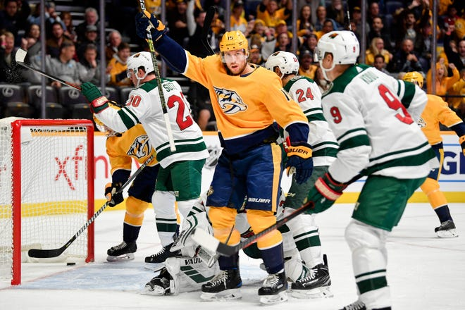 Nashville Predators right wing Craig Smith (15) reacts after scoring against the Minnesota Wild during the first period at Bridgestone Arena in Nashville, Tenn., Monday, Oct. 15, 2018.