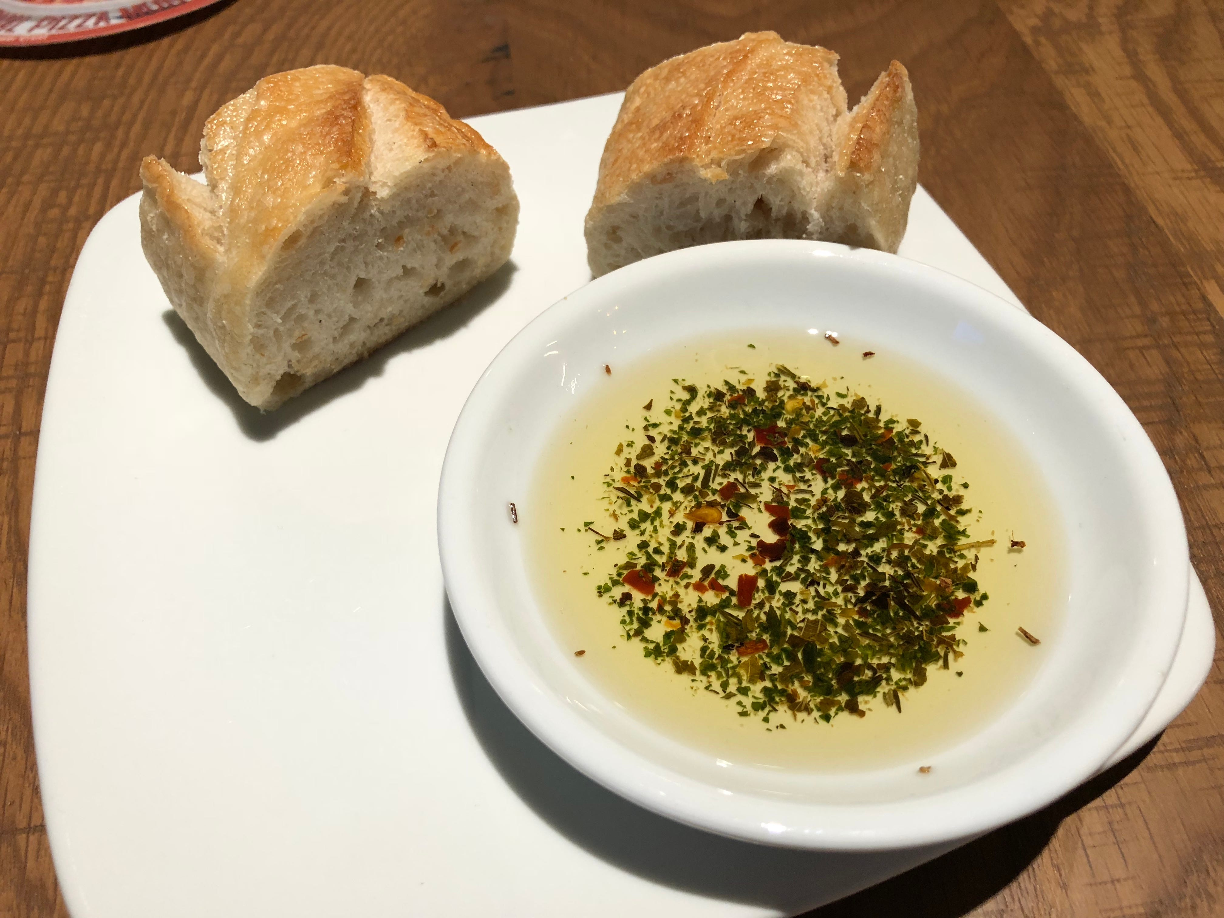 Your lunch at California Pizza Kitchen starts off with a sampling of warm, crusty bread with seasoned olive oil for dipping.