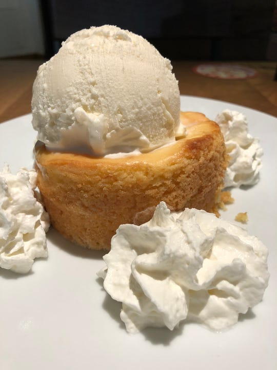 This dessert is a delicious combo of warm cake with homemade whipped cream and vanilla ice cream. Be sure on your first bite to get a little of each for maximum flavor.
