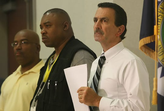 Detective Pat Postiglione, right, and other detectives listen while Chief Ronal Serpas tells reporters that the McNair/Kazemi case was a murder- suicide on July 8, 2009.