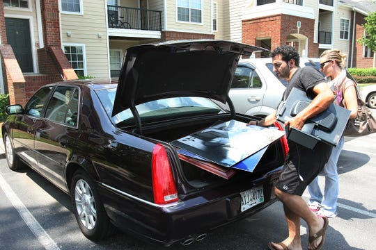 Nephew Farzin Abdi, nephew of Sahel Kazemi and former roommate Emily Andrews move Sahel Kazemi's possessions out of her condo. Right after the car was loaded Farzin Abdi drove to Florida with the possession and to said he was going to work on getting the funeral arrangements for Kazemi. (July 7 , 2009 JOHN PARTIPILO/THE TENNESSEAN)
