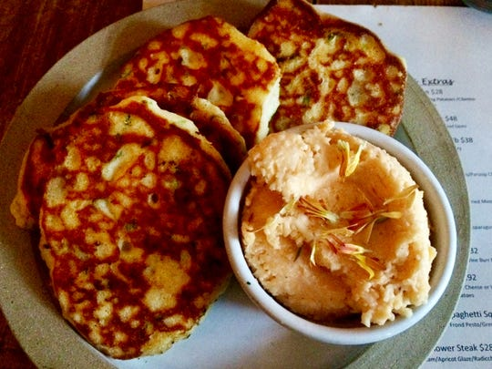 Whipped pimento cheese with hoe cakes, lemon, chili and scallion at 1892 restaurant in Leiper's Fork.