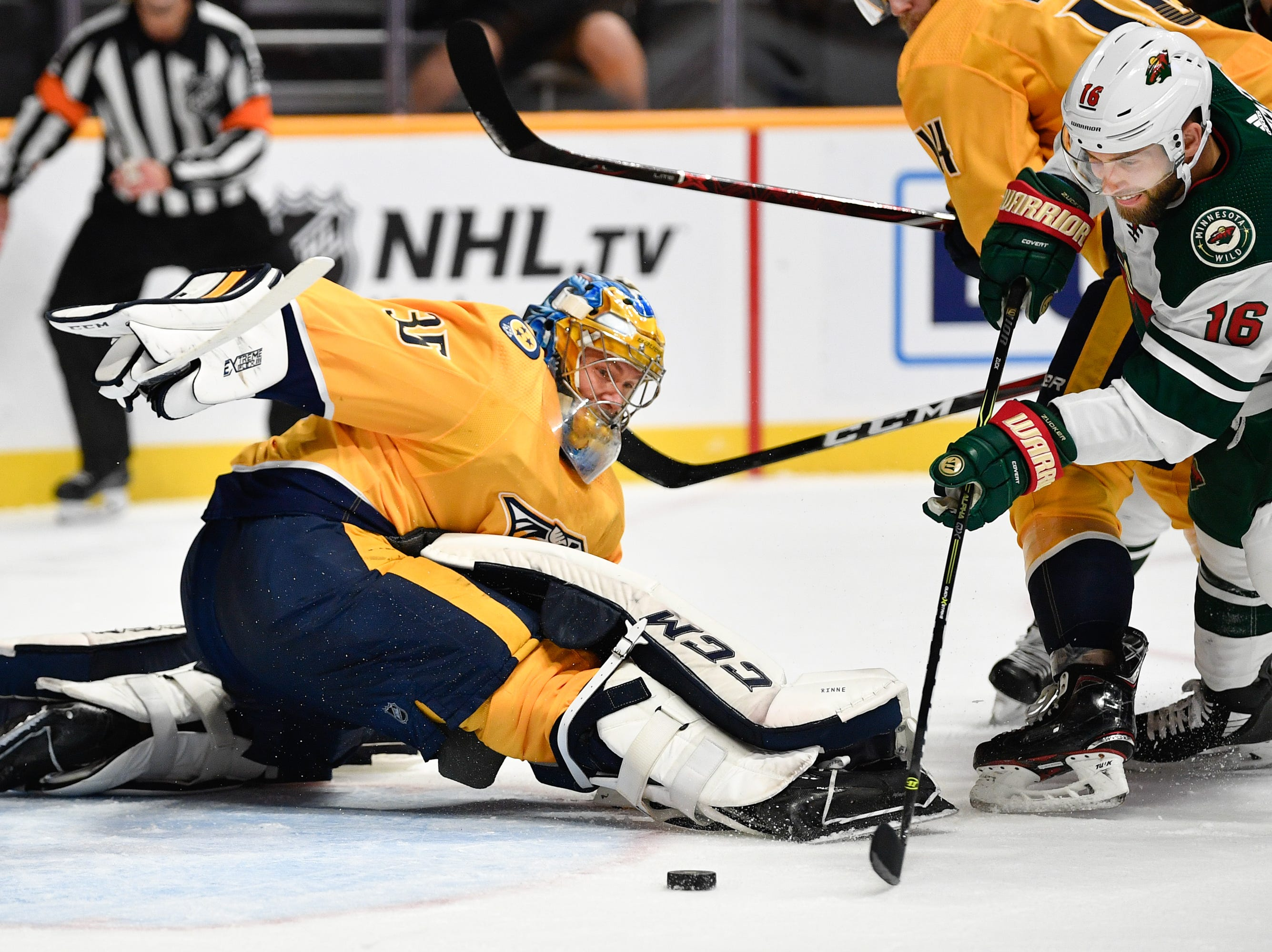 Nashville Predators goaltender Pekka Rinne (35) defends against Minnesota Wild left wing Jason Zucker (16) during the second period at Bridgestone Arena in Nashville, Tenn., Monday, Oct. 15, 2018.