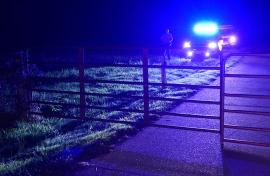 Law enforcement investigate the scene of a murder-suicide on Carters Creek Pike Monday, Oct. 15, 2018, in Columbia, Tenn. Four children and an adult woman were found dead in the home in an apparent murder suicide.
