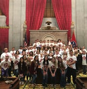 Seniors from Wayne County High School pose on the Tennessee House floor wearing the Rep. David Byrd shirts they were given.