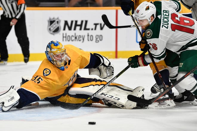 Nashville Predators goaltender Pekka Rinne (35) defends against Minnesota Wild left wing Jason Zucker (16) during the second period at Bridgestone Arena in Nashville, Tenn., Monday, Oct. 15, 2018.