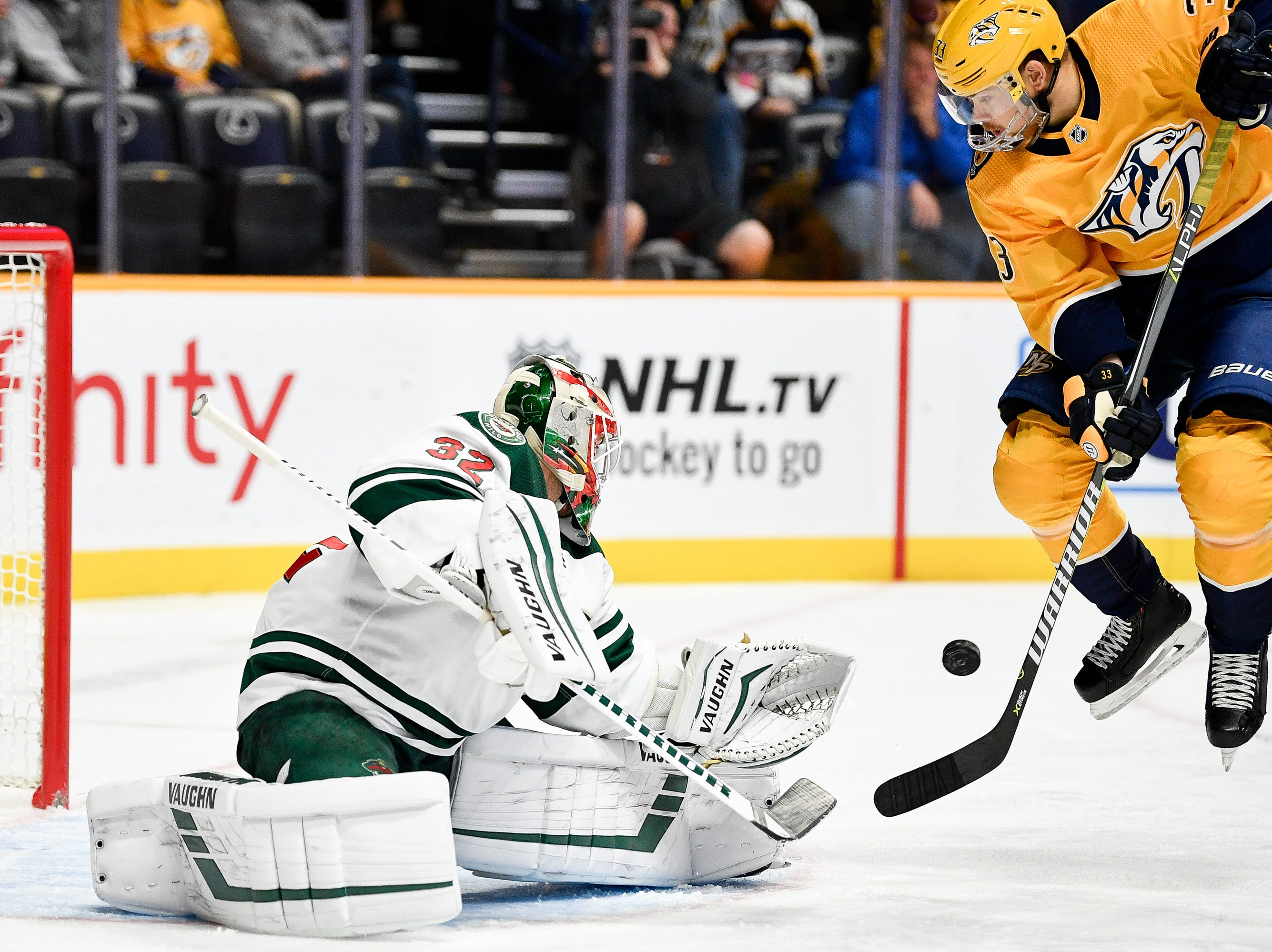 Oct. 15: Predators 4, Wild 2: Nashville Predators left wing Viktor Arvidsson (33) leaps as Minnesota Wild goaltender Alex Stalock (32) defends against a shot during the first period at Bridgestone Arena in Nashville, Tenn., Monday, Oct. 15, 2018.