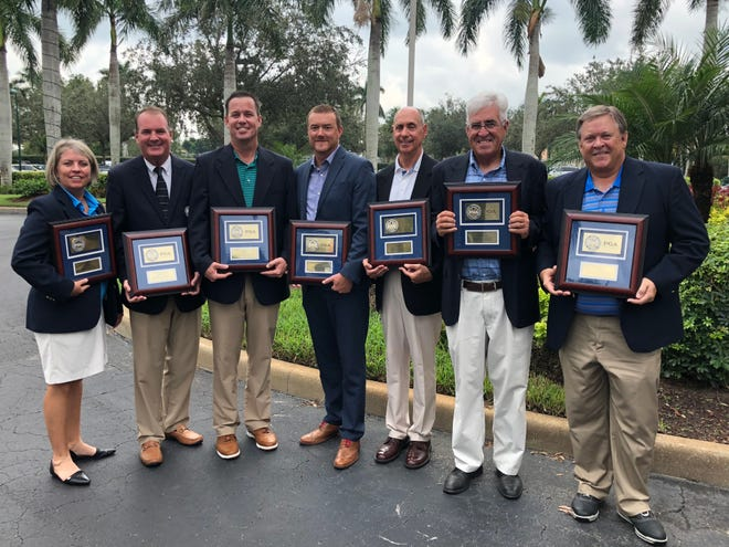 Southwest Chapter PGA award winners, led by Wildcat Run's Bill Harley as Golf Professional of the Year, pose with their plaques after the organization's fall meeting at Legends Golf & Country Club in Fort Myers on Thursday, Oct. 11, 2018