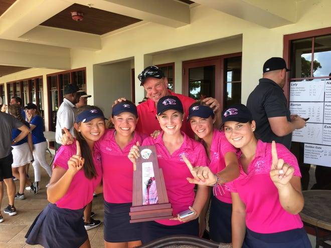 The Estero Wildcats capture the 2A-District 21 title on Monday, Oct. 16, at Hibiscus Golf Club. From left: Kim Egozi, Chrissy Mackie, Meredith Brown, Kelli Kragh, Mackenzie Brown and Coach Norm Heyboer in back.