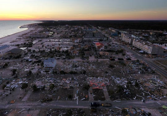 In this Oct. 12, 2018, file photo, damaged homes are seen along the water's edge in the aftermath of hurricane Michael in Mexico Beach, Fla.