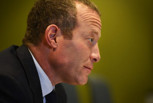 Photo of Josh Gottheimer, Democrat, 5th Congressional District, is being photographed during the Edit board meeting at the Record's office in Woodland Park on 10/15/18.