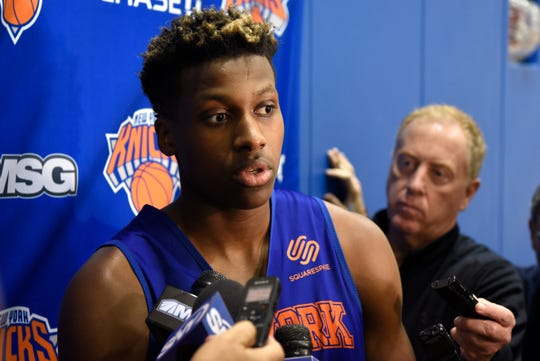 New York Knicks' Frank Ntilikina talks to reporters after practice on Tuesday, Oct. 16, 2018, in Greenburgh, N.Y.