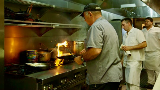 Owner Fred Osso cooks at Rudy's.