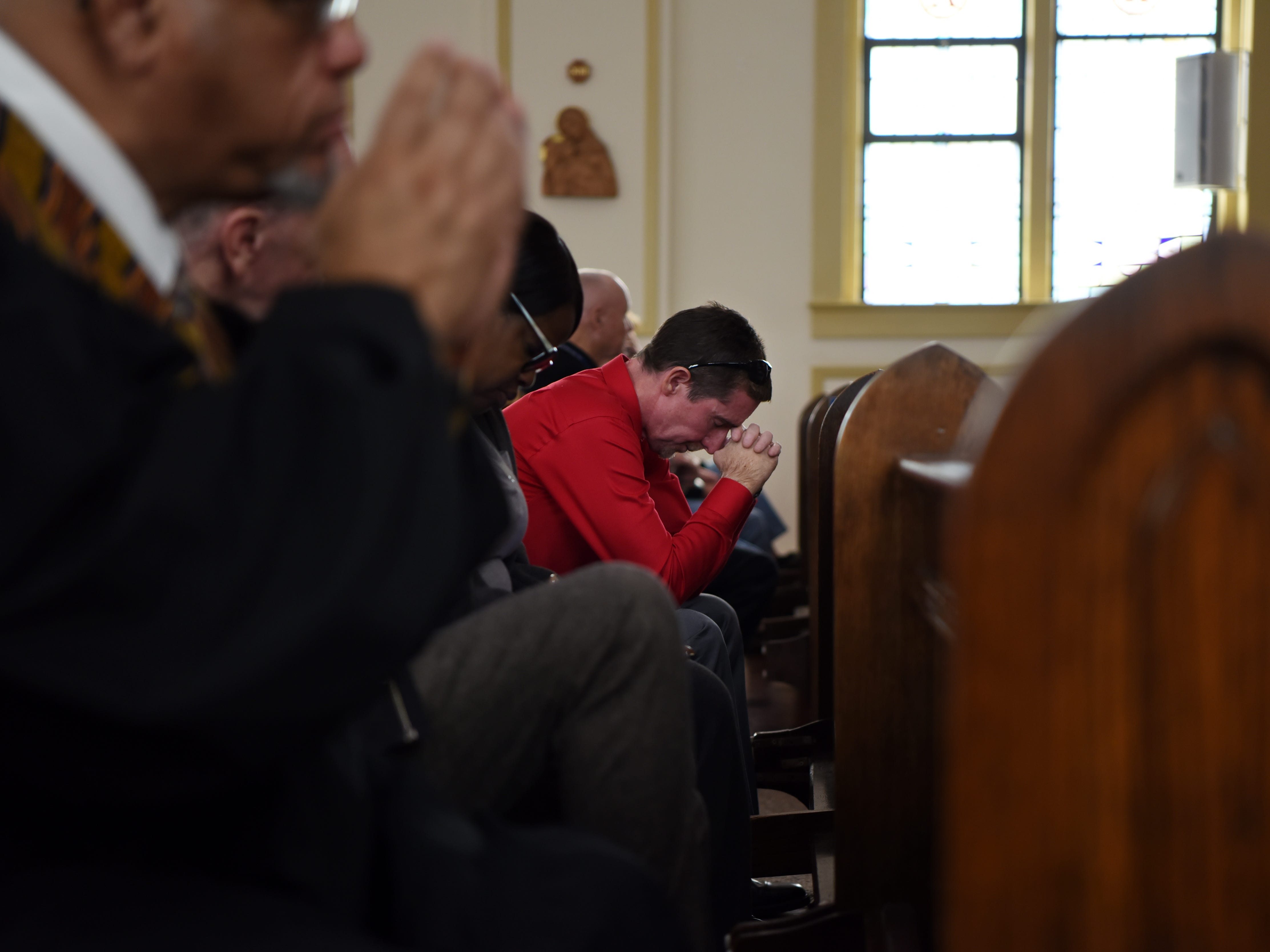 John, the drummer in the Straight & Narrow Gospel Choir, prays during Mass at St. Joseph's Roman Catholic Church in Lincoln Park on Sunday, Oct. 14, 2018.