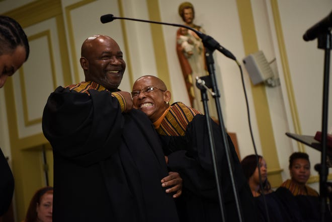 Irv DeBois, left, and Pat Solomon share a laugh as members of the Straight & Narrow Gospel Choir practice before their performance at St. Joseph's Roman Catholic Church in Lincoln Park on Sunday, Oct. 14, 2018.