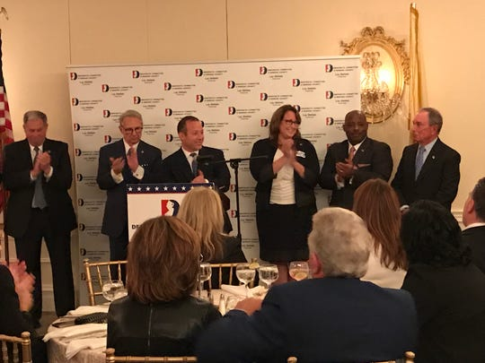Rep. Josh Gottheimer introducing former New York mayor Michael Bloomfield on Monday night. With him are l to r, Bergen County executive Jim Tedesco, Democratic chairman Lou Stellato, freeholder Tracy Zur, and sheriff candidate Anthony Cureton.