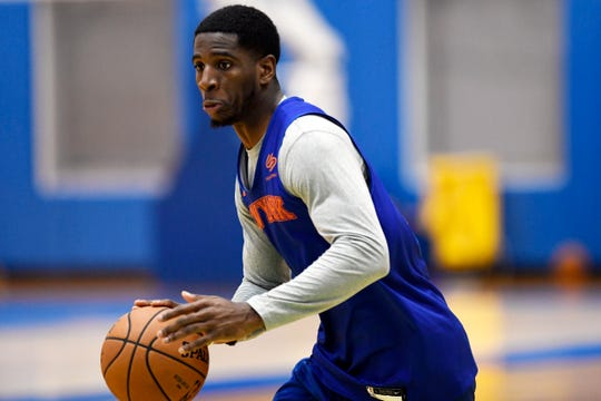 New York Knicks' Damyean Dotson dribbles the ball during practice on Tuesday, Oct. 16, 2018, in Greenburgh, N.Y.