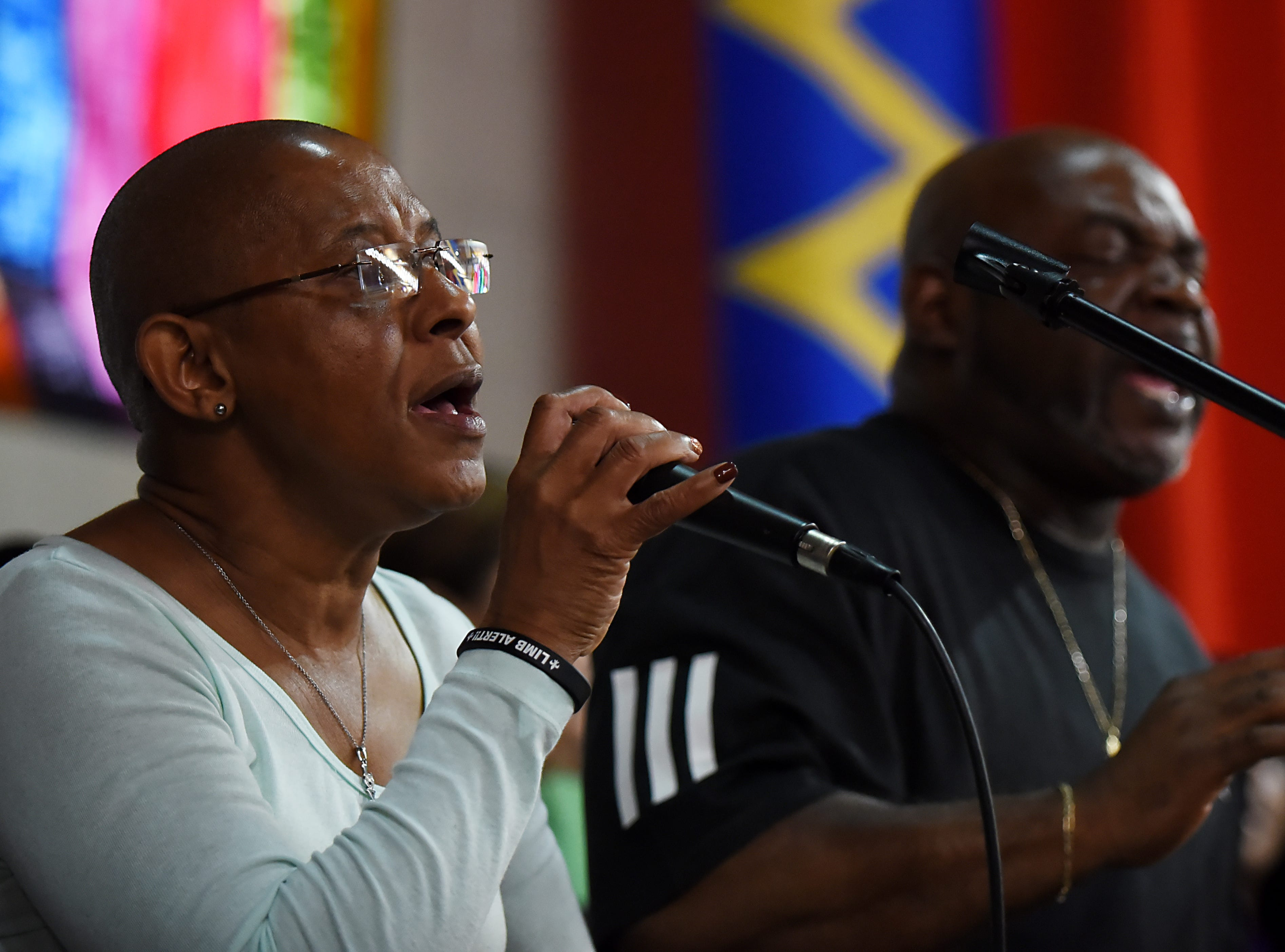 (From left) Pat Solomon and Irv DeBois, singers in the Straight and Narrow Choir, practice at the Straight and Narrow great hall in Paterson on Saturday October 13, 2018.