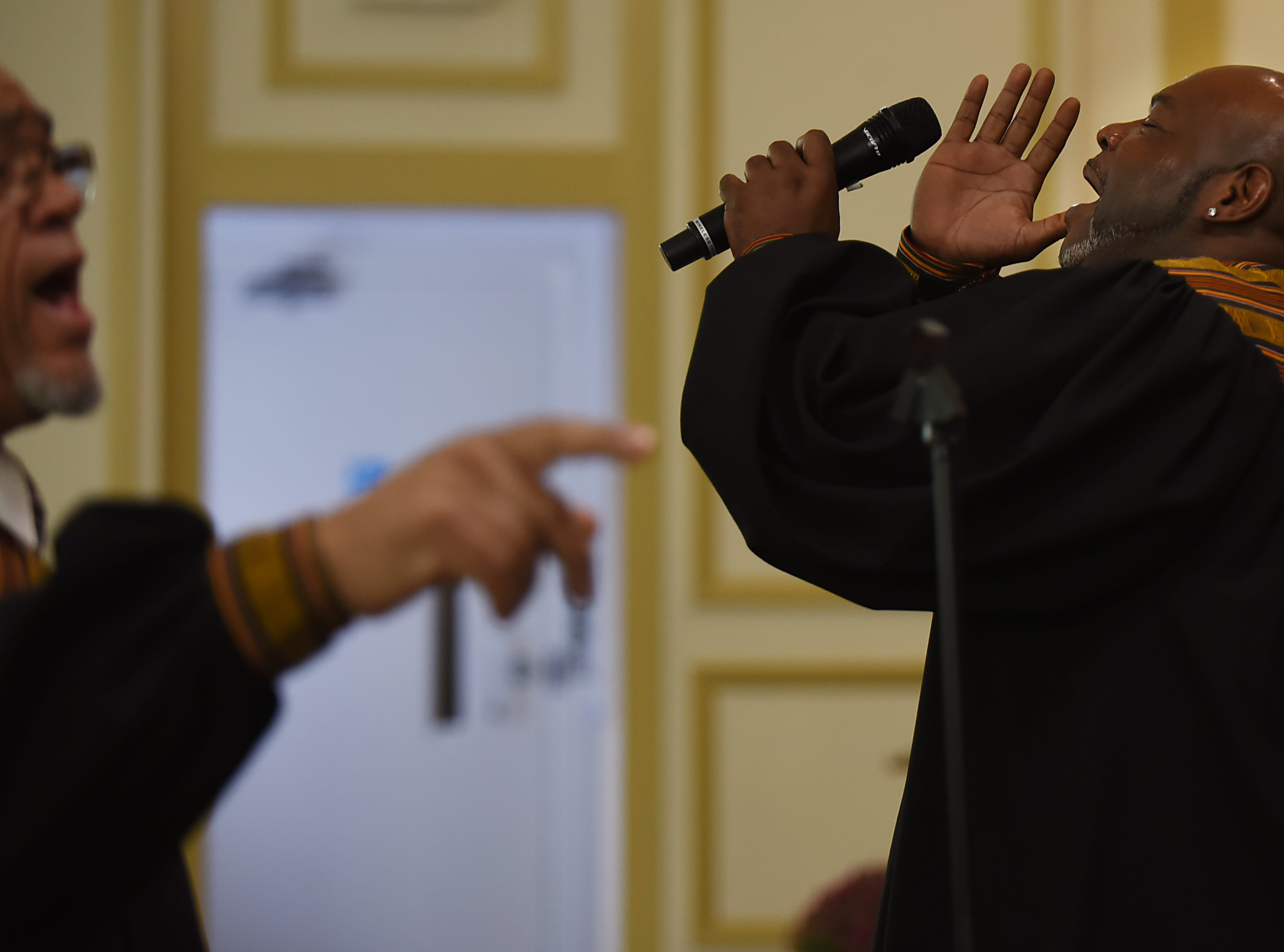 (From left) Elton West and Irv DeBois with the Straight and Narrow Choir during a performance at Saint Joseph's Roman Catholic Church in Lincoln Park on Sunday October 14, 2018.