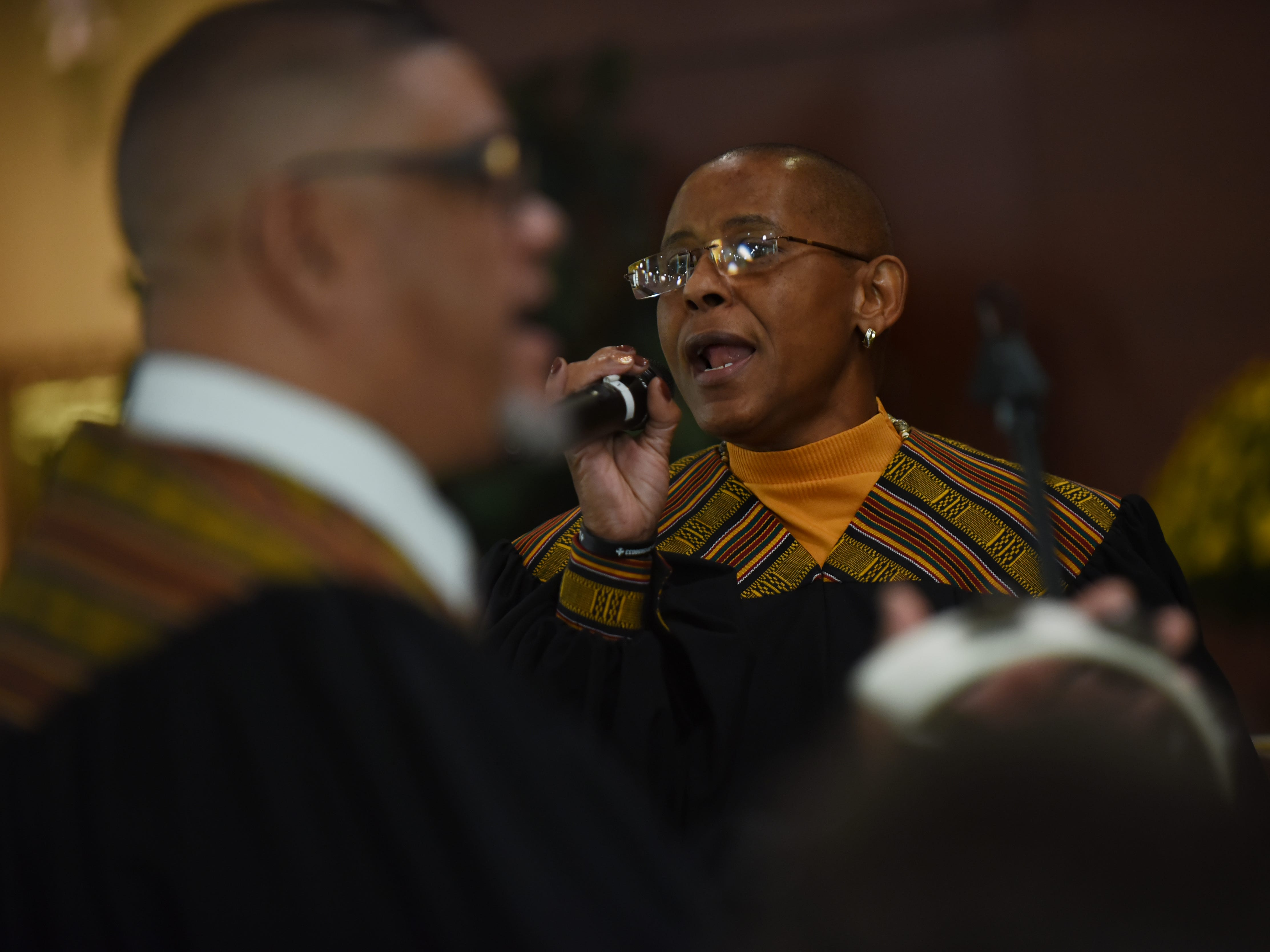 (From left) Elton West and  Pat Solomon with the Straight and Narrow Choir during a performance at Saint Joseph's Roman Catholic Church in Lincoln Park on Sunday October 14, 2018.