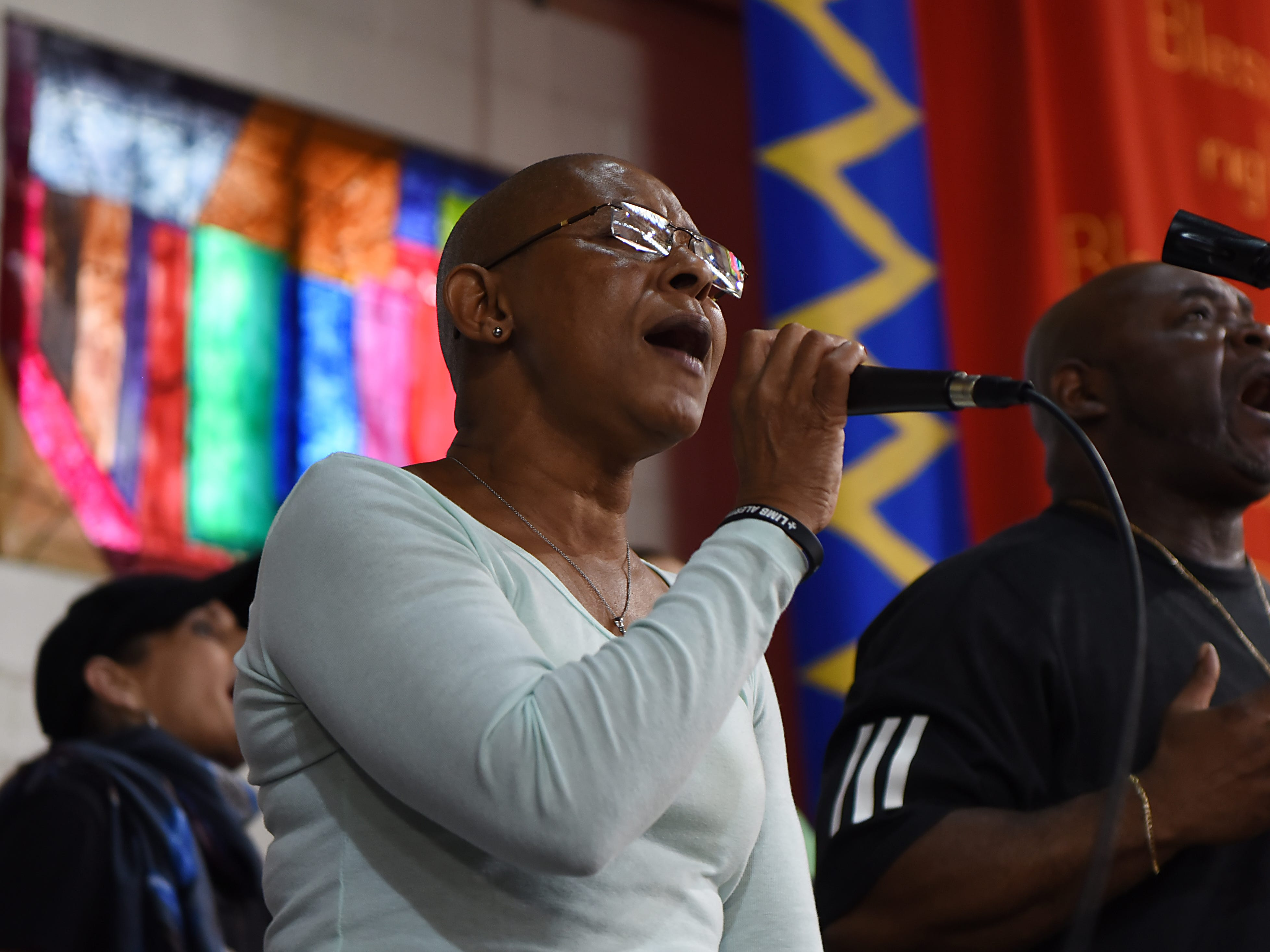 Pat Solomon, left, and Irv DeBois, singers in the Straight & Narrow Gospel Choir, practice in the organization's great hall in Paterson on Saturday, Oct. 13, 2018.