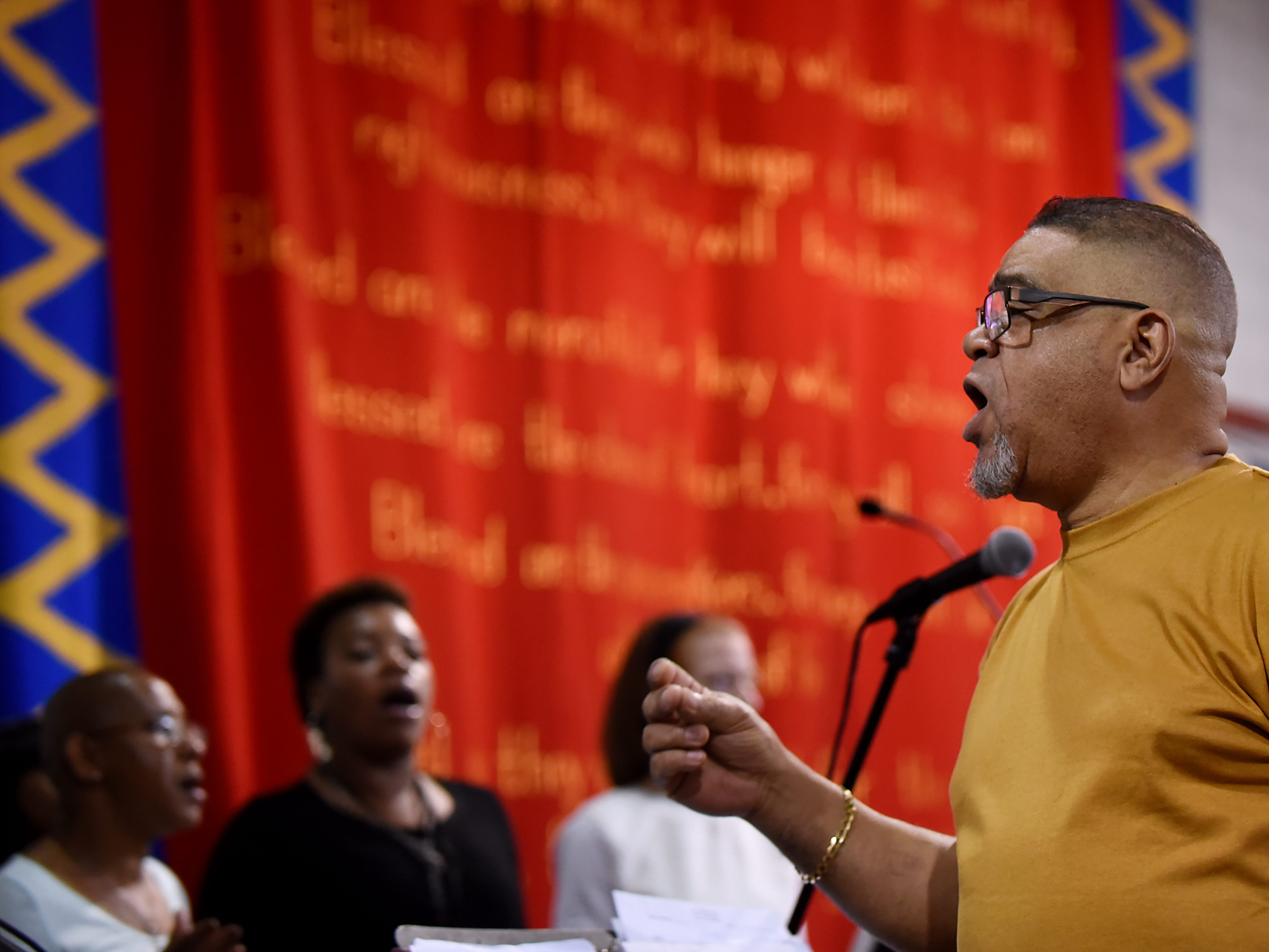 Elton West, conductor for the Straight and Narrow Choir, practices at the Straight and Narrow great hall in Paterson on Saturday October 13, 2018.
