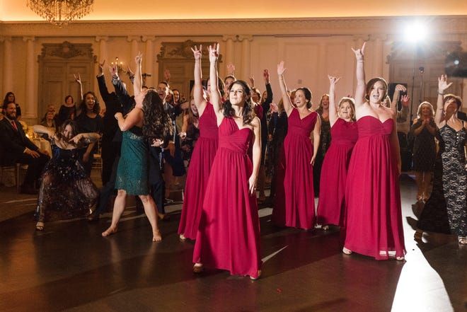 Lisa Adams and Justin Friedman were surprised at their Oct. 5, 2018 wedding with a flash mob from the matron of honor.