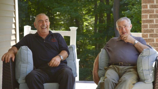 Fred Osso, left, and Charlie Osso, right, laugh while sharing a story in 'Pizza Shop' documentary, which tells their story.