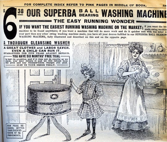 Just sit back and let the machine do all the work. Or not. The little girl operating this deluxe 1908 washing machine could probably give you an earful.