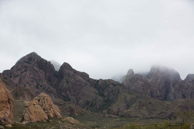The Organ Mountains are shrouded by low cloud cover on Tuesday October 16, 2018, an unseasonably cold day in southern New Mexico.