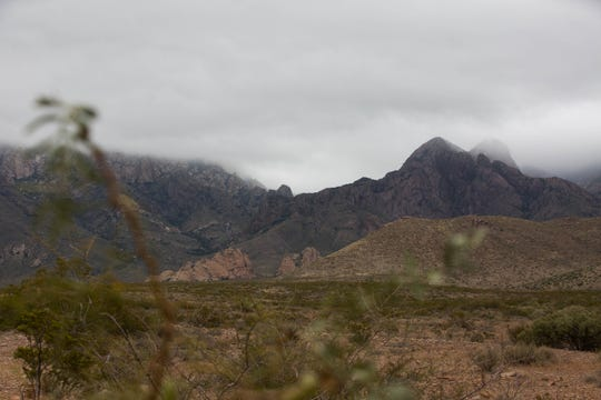 Clouds hang low in the Organ Mountains on Tuesday, Oct. 16, 2018. A blanket of cloud cover is helping to keep the temperatures colder than usual, a meteorologist told the Sun-News.