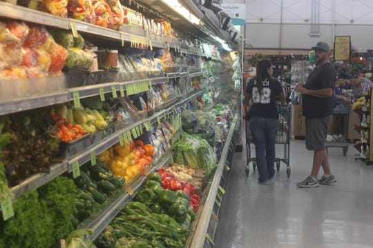 Produce aisles are fully stocked, Sept. 25 at Albertsons in Carlsbad.