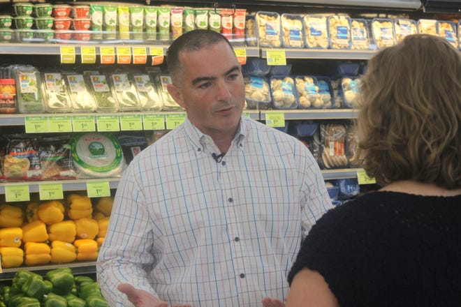 John Jameson, regional vice president of the United Family, discusses the oil boom's impact on Carlsbad's grocery industry, Sept. 25 at Albertsons in Carlsbad.