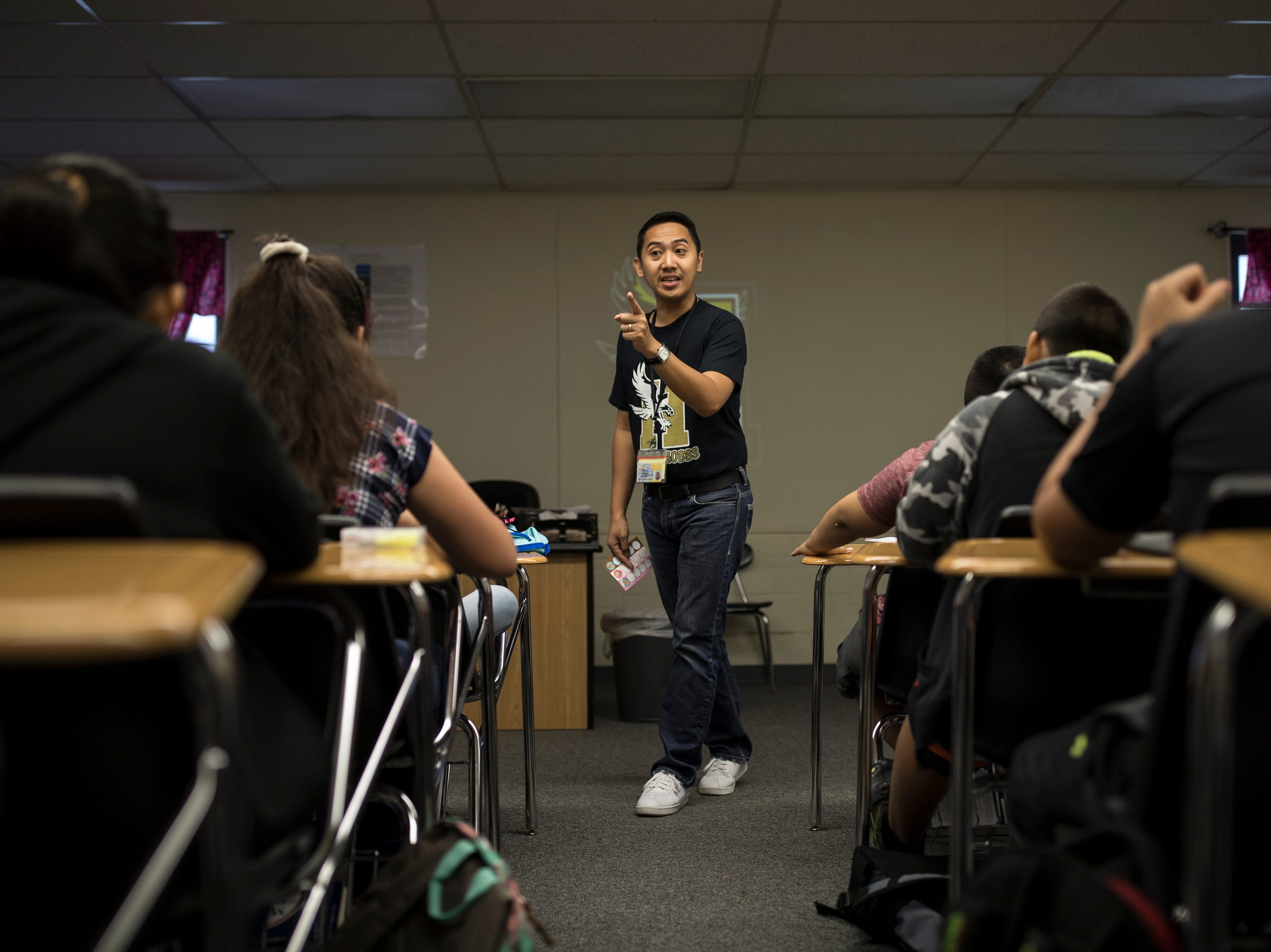 "Teacher Jemmry Velasquez instructs his class at Heizer Middle School where they went over bullying by peers. Velasquez is one of the 39 teachers in Hobbs Municipal Schools teaching on a J-1 ""cultural exchange"" visa that was recruited to instruct in the United States."