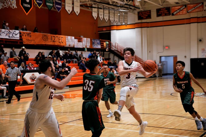 Aztec's Gabe Wood (3) drives to the basket during a nondistrict basketball game against Wingate on Jan. 27 at Lillywhite Gym. The Tigers open the new season Nov. 29 at the Jerry Richardson Memorial tournament in Shiprock.