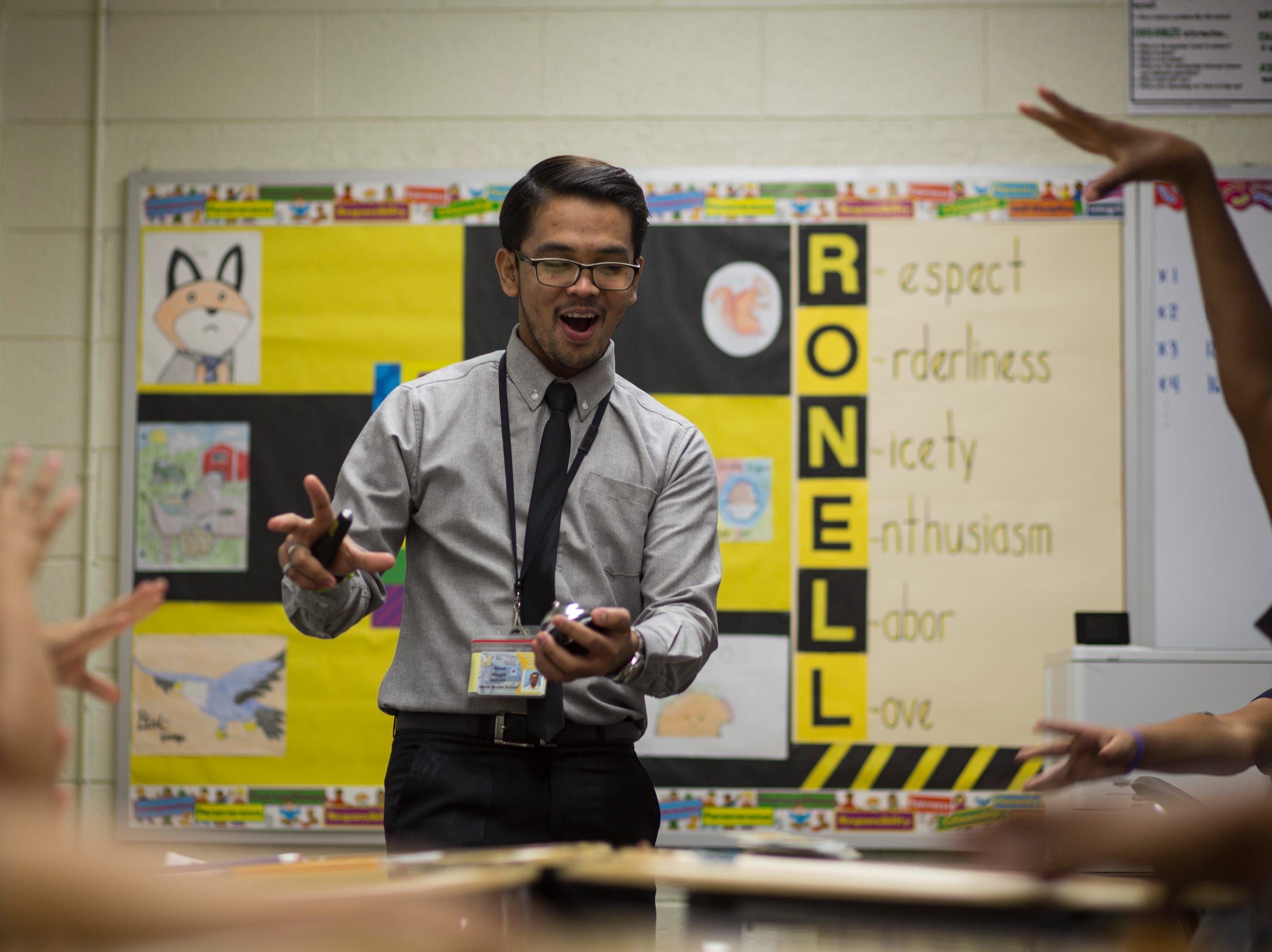 "Filipino teacher Ronell Mangilit instructs the largest of his sixth grade math classes at Heizer Middle School in Hobbs, NM. ""Mr. M,"" as the students refer to him, uses music, animated lessons and games as a way to encourage learning in his classes."