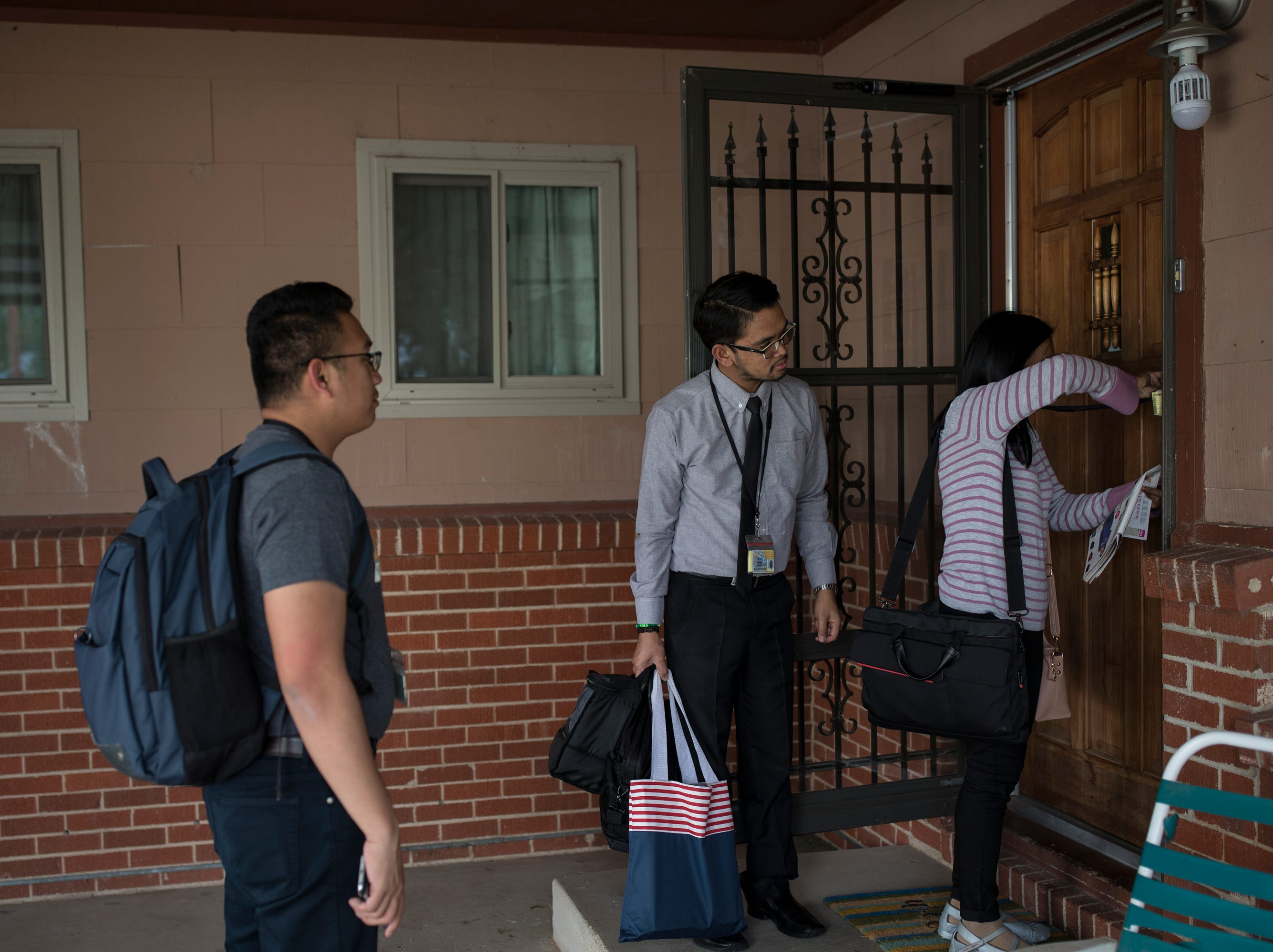 From right, Margaret Pel, Ronell Mangilit and Kim Alrod Araza arrive at the home they share with one other teacher in the town of Hobbs, NM. Many of the Filipino teachers must share housing as some are burdened with monthly debt payments to recruiters whose fees are anywhere from $5000-$15,000 not including extra expenses that aren't calculated for.