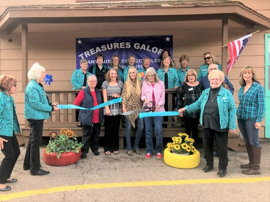 Valley Greeters and the Chamber of Commerce welcome Treasures Galore to the area wishing them the best at a ribbon-cutting ceremony.