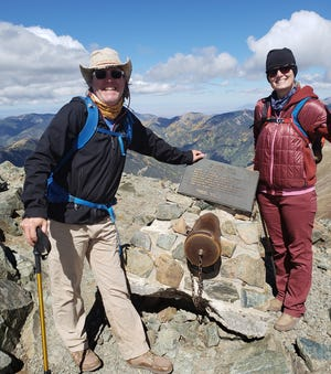 Rich and Anna Dozier stand on Wheeler Peak's summit that's named after Maj. George Montague Wheeler.