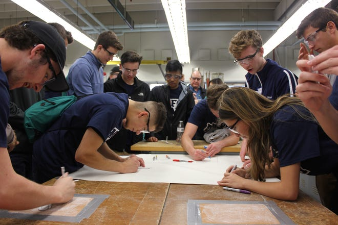Some 200 Plymouth-Canton Community Schools students visited Eastern Michigan University for manufacturing day.