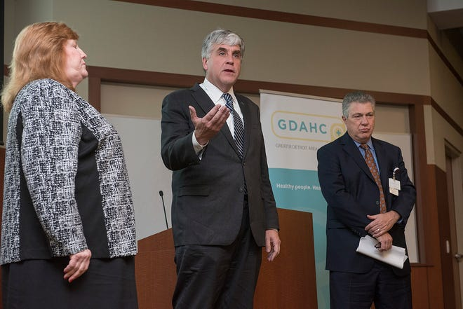 Health and Human Services Deputy Secretary Eric Hartgan takes questions from the media after the rountable discussion with local leaders in the battle against the opioid crisis, including Kate Kohn-Parrott, President and CEO of the Greater Detroit Area Health Council, and David Spivey, President and CEO of St. Mary Mercy Hospital.