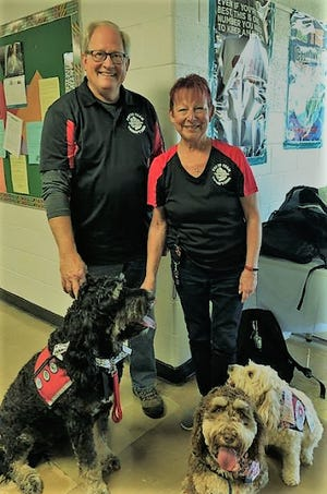 Paul and Bonnie Barbick of Pinckney visit Cambridge High School with their therapy dogs Monroe, Rosalee and Adalind on Tuesdays