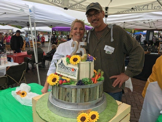 """Oakland Community College culinary chef instructor Lois Hennessey and market manager Walt Gajewski celebrate what has been a """"memorable year"""" for the farmers market, with a year-long commemoration of its 25th season in downtown Farmington."""