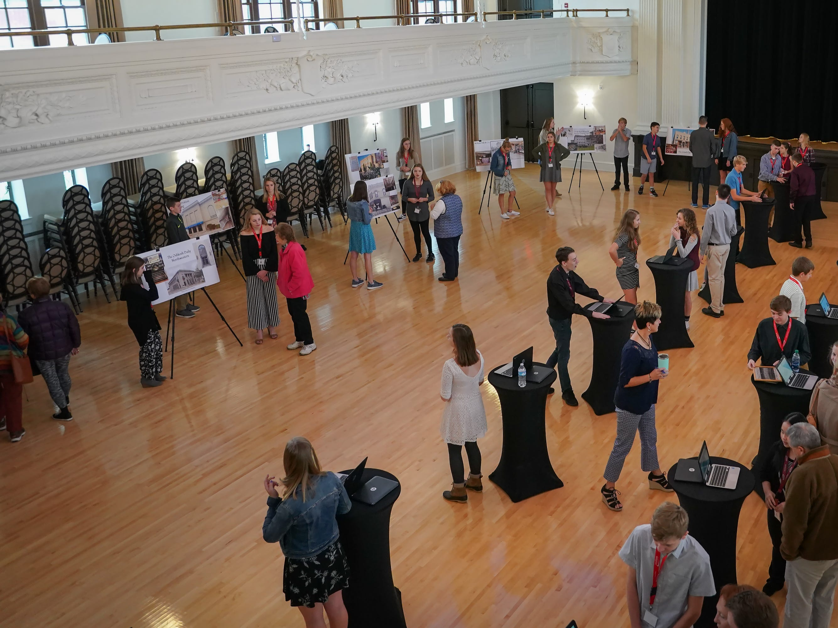 People attend the Oshkosh North Communities program's Historic Oshkosh event Tuesday at The Howard.