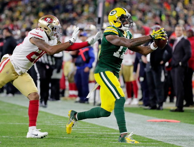 Green Bay Packers wide receiver Davante Adams (17) runs out of bounds after making a catch late in the fourth quarter against the San Francisco 49ers at Lambeau Field on Monday, October 15, 2018 in Green Bay, Wis.