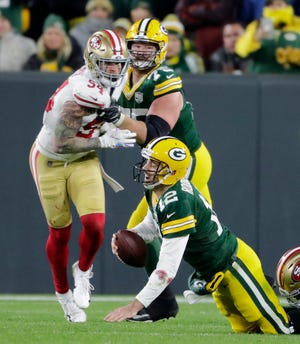 San Francisco 49ers defensive tackle DeForest Buckner (99) sacks Green Bay Packers quarterback Aaron Rodgers (12) in the fourth quarter at Lambeau Field on Monday, October 15, 2018 in Green Bay, Wis.