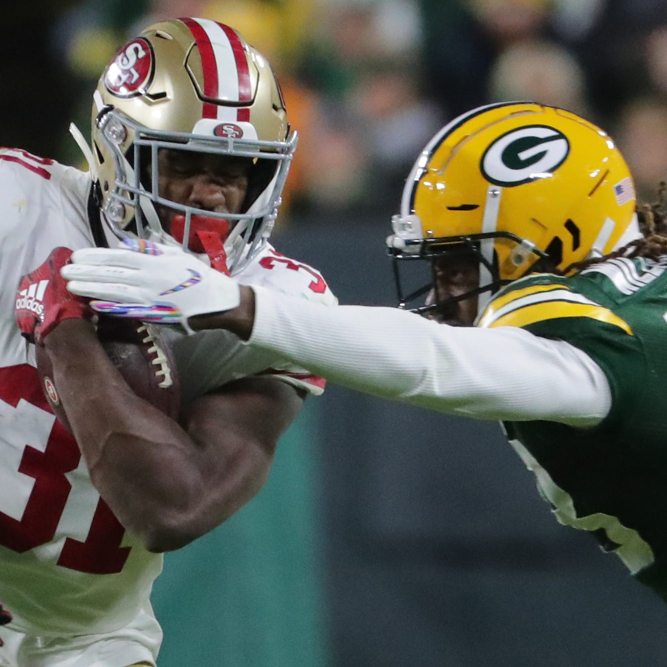 San Francisco 49ers' Raheem Mostert (31) breaks an arm tackle by Green Bay Packers cornerback Tramon Williams (38) during the fourth quarter of their game Monday, October 15, 2018 at Lambeau Field in Green Bay, Wis. The Green Bay Packer beat the San Francisco 49ers 33-30.MARK HOFFMAN/ MHOFFMAN@JOURNALSENTINEL.COM