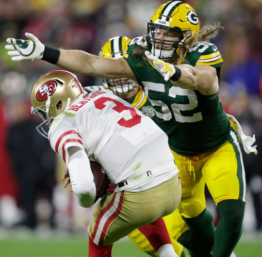 Green Bay Packers linebacker Clay Matthews (52) sacks San Francisco 49ers quarterback C.J. Beathard (3) late in the fourth quarter during their football game Monday, Oct. 15, 2018, at Lambeau Field in Green Bay, Wis.