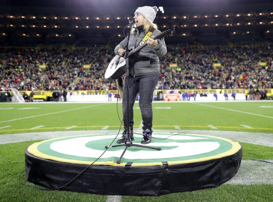 Melissa Etheridge performs at halftime of the Green Bay Packers-San Francisco 49ers game on Monday at Lambeau Field in Green Bay.